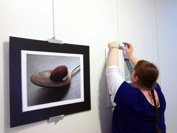 Finlandia art and design student Tori Schwanke installs work by Hailey Macias: These Nuts, digital photography