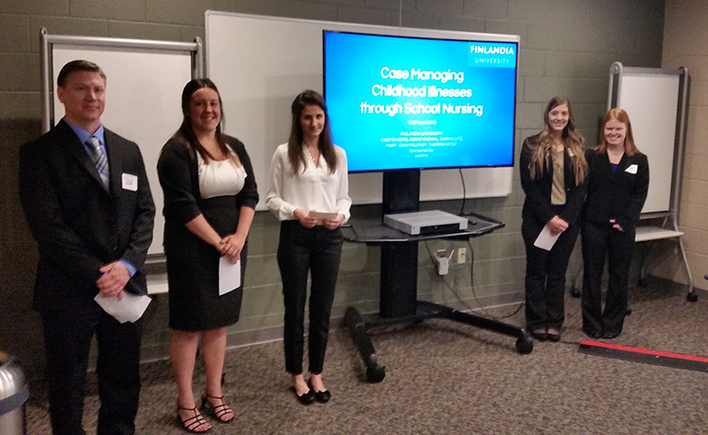 Students from Finlandia University's THE Project team pose for a photo in Grand Rapids at the competition.