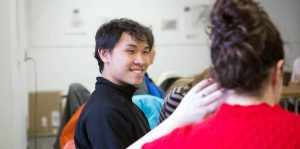 College student smiling in classroom.