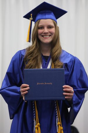 Melissa Amburgey, who earned a spot on the Dean's List for her efforts during the Spring 2016 semester, poses for a photo at the 2016 Finlandia University commencement ceremony.