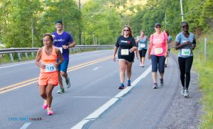 Finlandia employees Michael H. Babcock and Augustine Brutus running during the 2016 Canal Run. This year's event is July 15, and will make a great goal whether you want to run or walk five miles, 10 miles or take a try at your first half marathon. Learn more at hancockcanalrun.com.