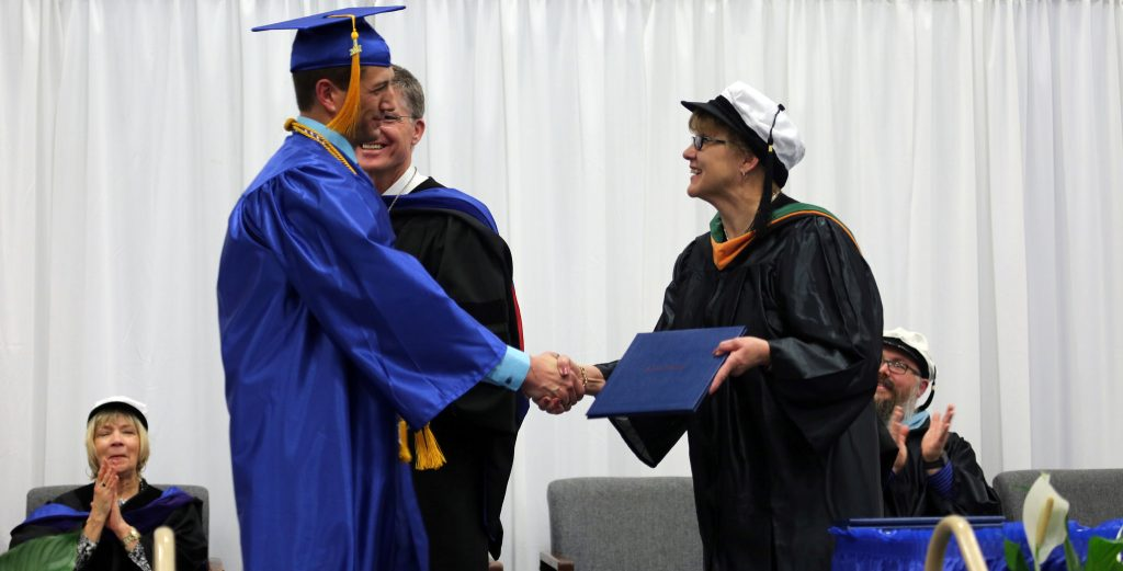 Graduate on Stage at FinnU