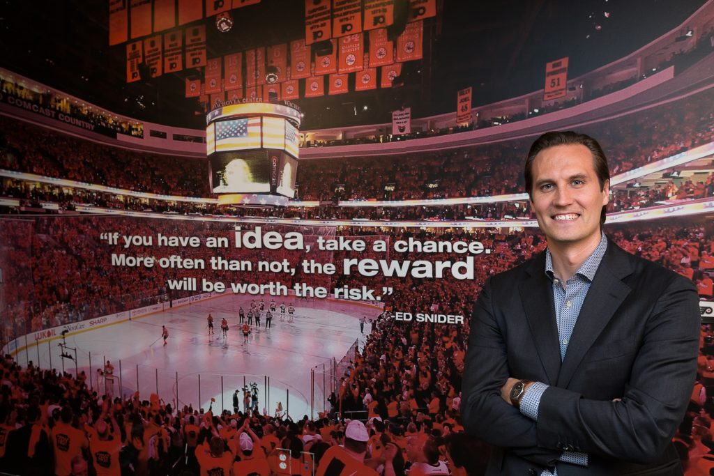 Ilkka Kortesluoma in front of a quote by Ed Snider