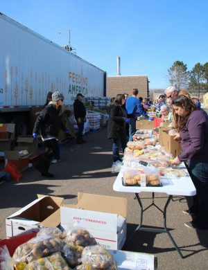 Students volunteer at mobile food pantry