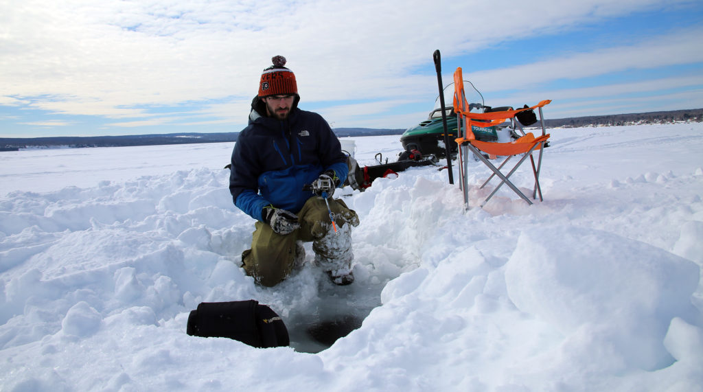 Biology Student Ice Fishing for Lake Trout