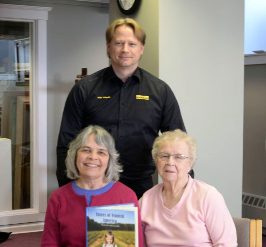Juha Vidgrén with Marja Kilpelä (left) and Hazel Tepsa, who contributed recipes to the book.