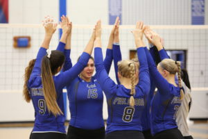 Women's volleyball pregame warmup.