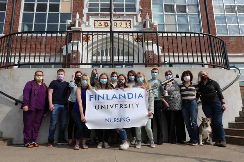 FinnU Nursing Students posing in front of the Hirvonen College of Health Sciences